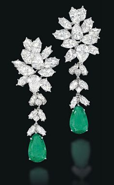 A PAIR OF EMERALD AND DIAMOND EAR PENDANTS   Of foliate design, the pear-shaped emerald suspended from a detachable diamond line to the pear and marquise-cut diamond cluster surmount, 5.7cm long
