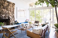 Midcentury furniture + white walls + pops of color | See more images from at home with emily henderson on domino.com