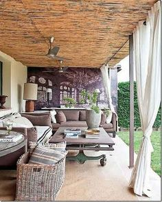 love the patio curtains and fans...check out that coffee table's legs!