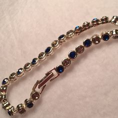 🌹Vintage32 Blue and White Crystals Silver 🌹Beautiful Blue and white round crystals nestled in a shiny silver setting. Condition: vintage. Thank You for visiting BlackBeards Lost Treasure where all Treasures are Pre owned/used, examined, & researched (5>=90 hrs). We search the USA for Lost Rare Irreplaceable Treasures. All Treasures were all pre-loved and were cherished. Age < 100 years. Condition: Consistent with age and wear. 🎀Vintage Designer is unknown. Ann Taylor Jewelry Bracelets
