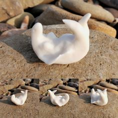 Soulskin, White Selkie basking in the autumn sun on the sea shore. Contemplating her next dive deep into the ocean to recover her lost treasure. Small hand made porcelain figurine. For sale in Selkie_Arts Etsy shop for £12. By Alice Grey.