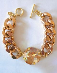 Pretty jewel & gold link bracelet .