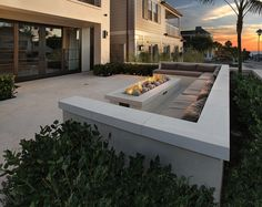 pavers with river rock and rectangular fire pit - Google Search