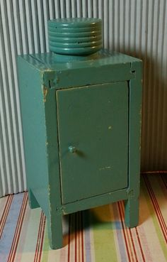 1930's Monitor-top refrigerator  Strombecker Type Vintage Painted Wood Dollhouse Furniture Kitchen Lot 1 12 | eBay  Auction of what I believe might be vintage wooden painted Strombecker dollhouse furniture from the 1930's. There's a  monitor-top refrigerator, hoosier hutch, table, two chairs and a stool.