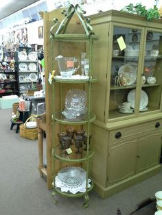 $79 - This is a vintage round metal and glass curio. The glass shelves are 16 inches in diameter and the overall height is 72 inches. It can be seen in Booth A6 at Main Street Antique Mall 7260 East Main St ( E of Power Rd ) Mesa 85207  480 9241122open 7 days 10 till 530 Cash or charge accepted