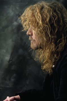 Robert Plant...this pic, seen before, shot a bit further back with different colors...