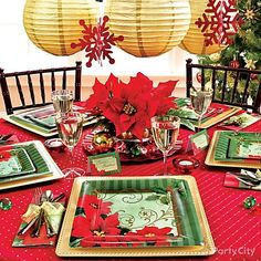 Give the holidays a modern twist! Try bold square-cut plates in an iconic pattern like Vintage Poinsettia. Hang decorations over the table for a festive finish!