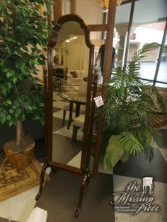 Classic and forever cheval mirror in mahogany by Ethan Allen. Measures 21*65.