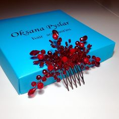 red beaded hair accessory