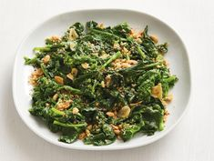 Get Spicy Coconut Broccoli Rabe Recipe from Food Network