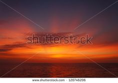 Offshore Sun Set (Red and Yellow Sky) - stock photo