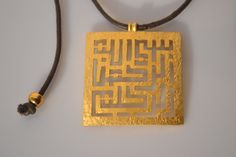 "Square Arabic Kufic Calligraphy ""Bismillah"" Hammered Necklace Handmade in Silver or Gold. From the Islamic Collection by Herafiyat, $89.00"