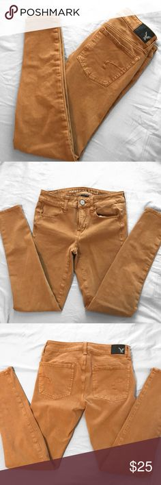 American Eagle Jeggings Super soft and super stretchy pair of Hi-Rise mustard colored jeggings!    Please note that the photo of the jeggings taken from the website are in different color! i just attached the image to show you how the jeans will look and fit. you will NOT receive the color shown on the model. you WILL get the color jeggings shown in the pictures i have taken. thanks! American Eagle Outfitters Jeans