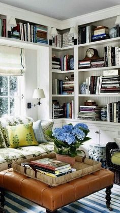 Adore this cozy library/living room.