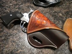 Single action hand carved leather featuring two tone brown and saddle tan