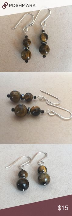 Beautiful Tiger Eye .925 Sterling Silver Earnings Made with 10 and 8mm Tiger Eye beads separated by hematite discs. Strung using fine .925 sterling silver. 100% handmade by me. A perfect match with the 10mm tiger eye bracelet we have for sale! Bundle and save 20% Thanks for stopping by🌴 Jewelry Earrings