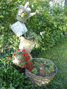 I like the washtub at the base with this rebar tipsy planter
