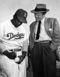 That's baseball ace Jackie Robinson who is greeted at Hollywood Baseball Park by screen star Van Heflin. Robinson is currently appearing as himself in a film version of his life and Heflin, an Old Robinson fan, was the first filmite to greet him on his arrival. Photo dated: March 11, 1950. #JackieRobinsonDay #Jackie42 #Dodgers