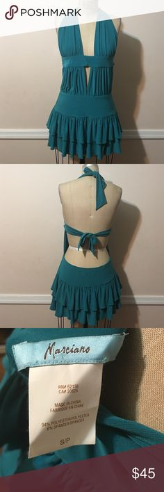 Marciano Teal Green Short Ruffle Dress Authentic Really cute and sexy Marciano teal green short ruffle dress. Halter tie and tie on the back, also deep V design. Worn twice almost like new. Marciano Dresses Mini