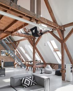 Poland-based Cuns Studio hung netted rope as a hammock in this spacious loft, accessible via custom steel stairs leading to a mezzanine. 📸: Hanna Długosz. #architecture #interior #design #interiordesign #apartment #poland #hammock #loft