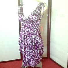 NEW Purple Cheetah Animal Print Draped Dress Small Go out in this fun draped party dress! With a purple and gray cheetah animal print per a white background. V neckline with empire waist and gathered detail. Attached belt ties behind the waist for a cute now. Zipper in back.  Sz Small  Approximate (material is stretchy) Length: 35 in Bust: 16 in Waist: 14 in  Material: polyester   Open to bundling!! City Triangles Dresses