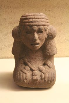 A statue of a kneeling goddess Chalchiuhtlicue, goddess of water. Aztec, British Museum.