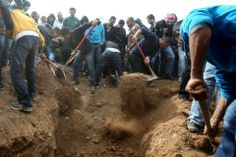 FILLING IN: People buried Salah Abu Latif in Rahat, Israel, Wednesday. Mr. Latif was working on the fence between Israel and Gaza when he was killed by a Palestinian sniper. (Jinipix/Xinhua/Zuma Press)