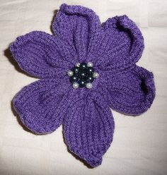 A Knitted Flower (with pattern)looks lovely on the headband I made or as a lone hair accessory!