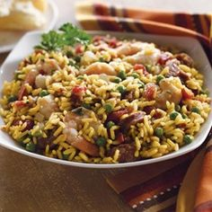 Feel like Spanish tonight? This paella recipe makes it easy with Zatarain& yellow rice, shrimp, smoked sausage, onion and peas. If you want to give it a little more South Louisiana flavor, use andouille sausage. Rice Dishes, Main Dishes, Pasta Dishes, Spanish Dishes, Spanish Recipes, Spanish Cuisine, Spanish Food, Paella Recipe, Creamy Chicken