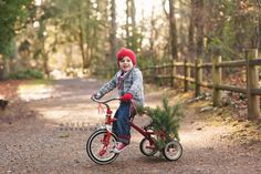 As soon as I took this one, I knew that I had to get it edited and share it  ASAP! Doesn't Atticus give you the Holiday warm & fuzzies? His grandparents  found this original trike at the Goodwill for a steal and his mama knew she  wanted it in photos.   Seattle kids photography, Seattle family photography, Seattle family  lifestyle photography, Seattle holiday photos, Holiday photos, Holiday  photo ideas, Holiday kids photos