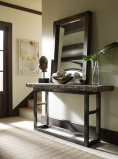 I love the use of the mirror in the entryway not only does this reflect light it also makes the entryway appear larger