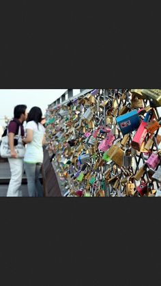 Why can't Americans be like this? This is a wall in Seoul South Korea were couple go and place a padlock on the fence and throw the key over the edge. They do it to symbolize their love for eachother
