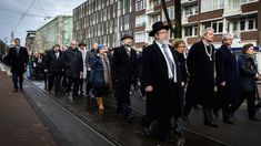 Antisemitism is rampant in Holland. Illustrative: Mayor of Amsterdam Eberhard van der Laan (4th R) leads a march from City Hall to the Auschwitz monument in the Wertheimpark in Amsterdam on January 26, 2014, during the national memorial day for the victims of the Holocaust. (AFP Photo/ANP/Remko de Waal via JTA)