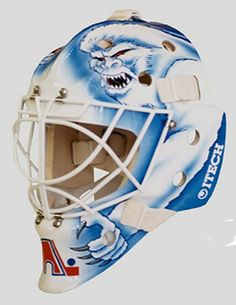 The goalies archive : goaltending history of every NHL teams Hockey Goalie, Hockey Players, Quebec Nordiques, Goalie Mask, Cool Masks, Masked Man, Sports Figures, Goalkeeper, Mask Design