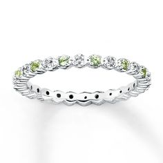 This stackable eternity band is set with alternating diamonds and peridots. It has a total diamond weight of 1/20 carat. The 2.25mm band is made of sterling silver. Diamond Total Carat Weight may range from .04 - .06 carats.  Gently clean by rinsing in warm water and drying with a soft cloth.