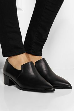 Heel measures approximately 40mm/ 1.5 inches Black leather Slip on