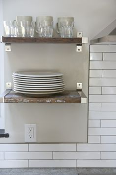 Reclaimed wood for open shelving with silver brackets and white subway tile with gray grout #LGLimitlessDesign #Contest