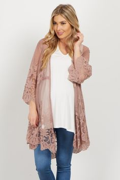 This boho chic lace crochet maternity kimono is everything you need and more this season. With its delicate lace and crochet accents, this bell sleeve kimono pairs beautifully with so many outfits. Style with a basic sleeveless top, maternity skinny jeans and booties for a complete look.