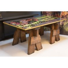Add something completely unique to your living space with the bespoke 'Reeds' table by Laura Oakes. With antique trestle table legs and layered Perspex top, this table is a quirky addition to any room. The Perspex surface features the 'Reeds' graphic design, which has been created using Laura Oakes' digital decoupage technique of layering foliage imagery over one another. All Laura Oakes furniture is designed by her in her Sussex studio and crafted from found materials of either a vintage or…