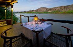 Dinner overlooking the Kunene River, Serra Cafema, Kaokoland, Namibia. @ Wilderness Safaris