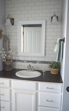 bathroom redo ideas. Low cost ways to renovate, using subway tiles and painting cabinet. Small bathroom problems are fixed with these key details, bringing in light and beauty.