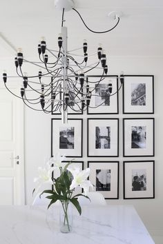 Homevialaura | Classic art wall | gallery wall in black and white | dining room | Flos 2097