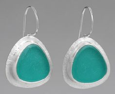 """Earrings with #Vintage #Recycled Mason Jar Glass, SALE: Was $140 , Now $115.  1"""" L x .75"""" W.  These elegant handmade drop earrings feature beautiful triangular pieces of aqua glass from a recycled vintage mason jar mounted in sterling silver. The silver is recycled too, making this wear-with-everything design doubly #eco-friendly. A perfect gift.  Amy Faust is a painter and jewelry designer who is always looking for inspiration from both the natural and urban environments."""