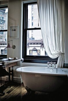 Like the idea of one curtain, swept to the side in the bathroom