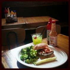 Vegan Burger with Pico de Gallo, side of broccoli,  a deeeelicious dill pickle and a Esqueleto Verde to wash it down.