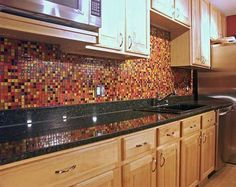 Backsplash Ideas For Granite Countertops | ... red glass tile colors reflect beautifully off the granite countertop