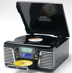 RECORDS/Encodes from Vinyl records or CD's onto MP3 Use USB stick or SD Memory Cards (up to 2Gb, not supplied). 60's style look Turntable: 3 speed 33/45 & e