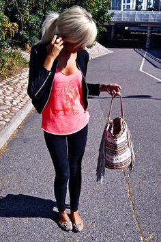 For some odd reason I find her outfit seriously adorable. Don't like the bag though.