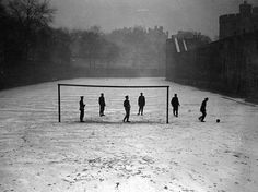 Guards play football in the snow at the Tower of London, January 1910