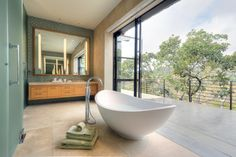 Love the shape of this bath tub and the free standing tap!